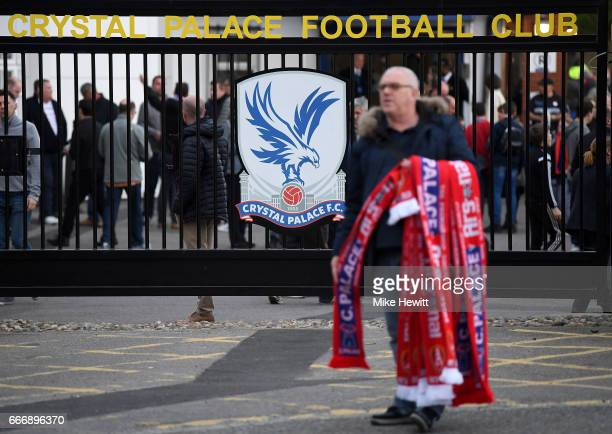 The club crest is seen as scarves are sold prior to the Premier League match between Crystal Palace and Arsenal at Selhurst Park on April 10 2017 in...