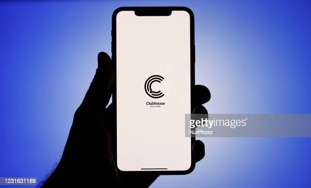 The Clubhouse application logo is seen on an iPhone screen in this photo illustration in Warsaw, Poland on March 10, 2021. The invitation-only audio...
