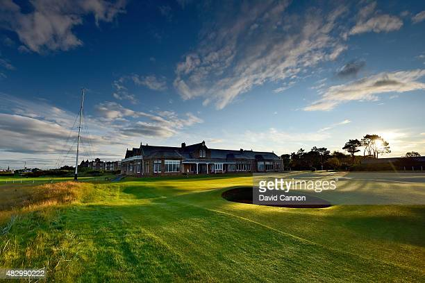The clubhouse behind the green on the 457 yards par 4 18th hole on the Old Course at Royal Troon at sunrise the venue for the 2016 Open Championship...
