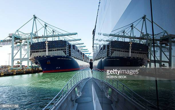 TOPSHOT The CMA CGM Benjamin Franklin the largest container ship to ever call at a North America port is reflected in the window of a tour boat while...