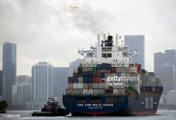 The CMA CGM White Shark cargo ship prepares to dock at PortMiami as the United States and China continue their trade war on May 16 2019 in Miami...