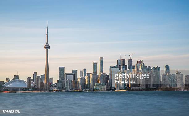 the cn tower and toronto skyline - toronto stock pictures, royalty-free photos & images