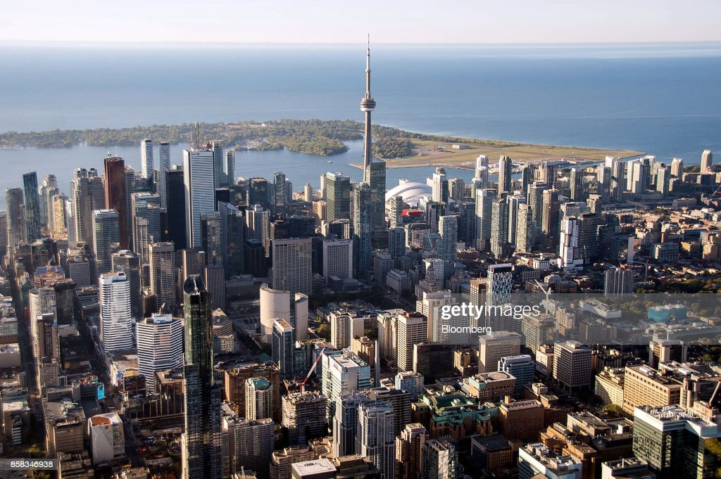 The CN Tower stands among buildings in the downtown skyline in this aerial photograph taken above Toronto, Ontario, Canada, on Monday, Oct. 2, 2017. Toronto housing prices fell for a fourth month in September as sales remained sluggish, particularly in the detached-home segment that has borne the brunt of the correction in Canada's biggest city. Photographer: James MacDonald/Bloomberg via Getty Images