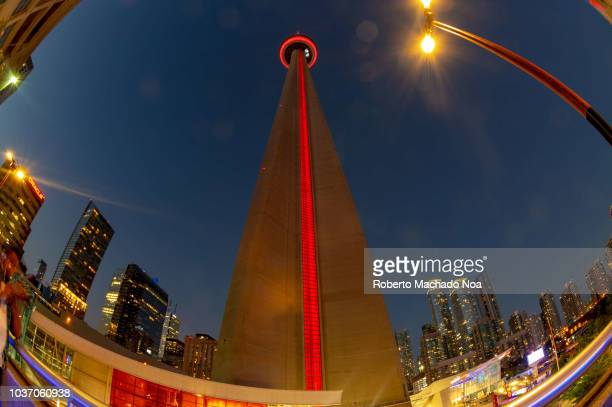 The CN Tower wide angle of the Canadian symbol at night The image is a low angle view