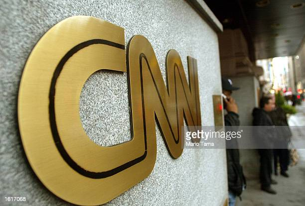 The CNN sign is seen outside its headquarters November 12 2002 in New York City The proposed merger between CNN and Walt Disney Co's ABC News is...