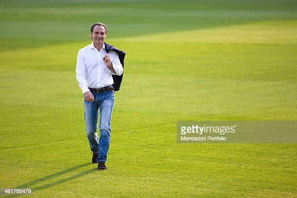 The coach and former football player Italian Cesare Prandelli coach of the Italian national team is posing while walking on a football field in...