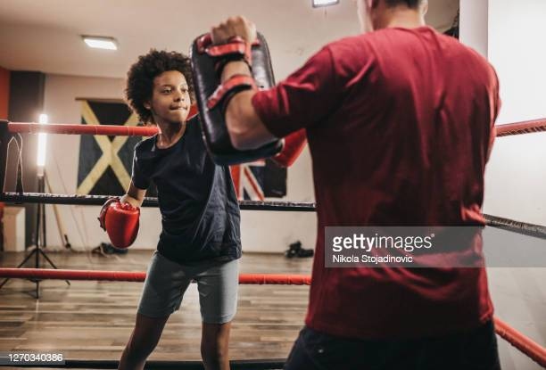 the coach and the girl are boxing - boxing stock pictures, royalty-free photos & images