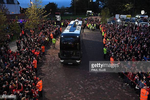The coach carrying Manchester United's players arrives at the ground ahead of the English Premier League football match between Liverpool and...