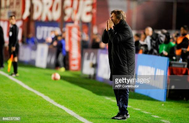 The coach of Argentina's team Atletico Tucuman Ricardo Alberto Zielinski gives instructions during their Copa Sudamericana football tournament match...