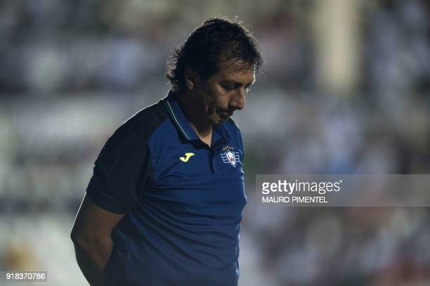 The coach of Bolivia's team Jorge Wilstermann Roberto Mosquera is pictured during the Libertadores Cup football match against Brazil's Vasco da Gama...