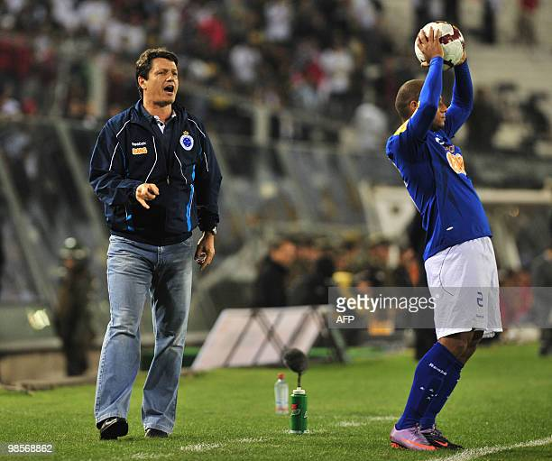 The coach of Brazilian team Cruzeiro Adilson Batista gives instructions to his players during a Libertadores Cup football match against Chile's Colo...