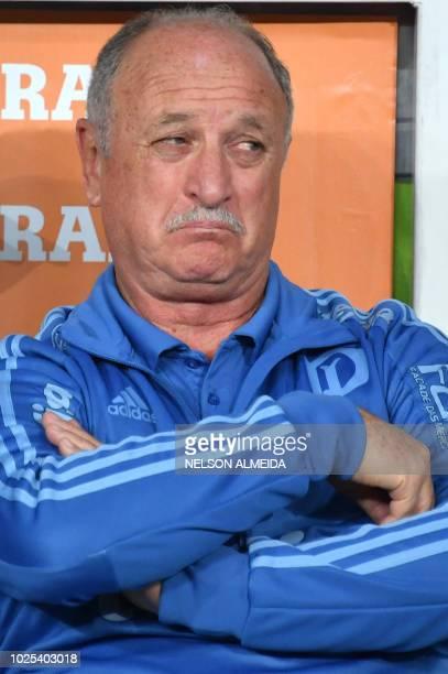 The coach of Brazilian team Palmeiras Luiz Felipe Scolari gestures during the Copa Libertadores football match against Paraguay's Cerro Porteno at...