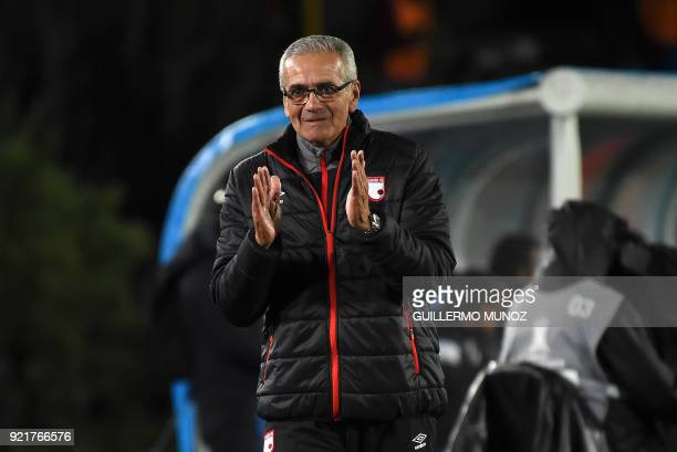 The coach of Colombian team Santa Fe Gregorio Perez gestures during their Copa Libertadores football match against Chile's Wanderers at the El Campin...