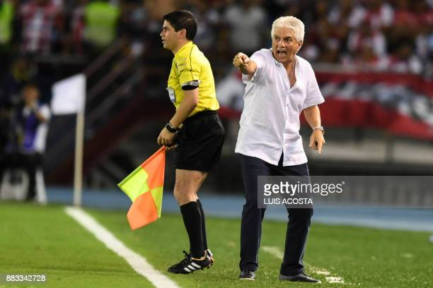 The coach of Colombia's team Junior Uruguayan Julio Comesana gestures during the Copa Sudamericana semifinal second leg football match against...