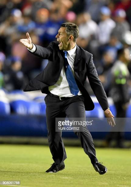 The coach of Cruz Azul Portuguese Pedro Caixinha gestures during the Mexican Clausura football tournament match against Leon at the Azul stadium in...