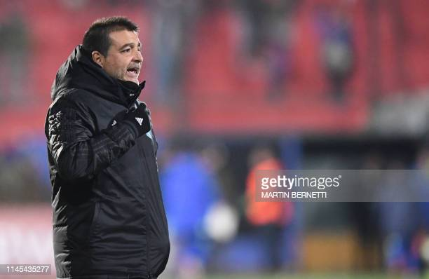 The coach of Peruvian team Sporting Cristal Argentine Claudio Vivas leaves the field after defeating Chile's Union Espanola 30 in a Copa Sudamericana...