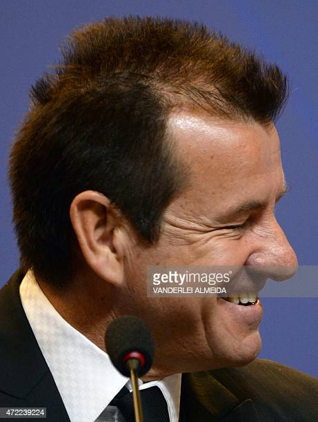 The coach of the Brazilian national football team Dunga laughs before announcing the 23player roster for the upcoming Copa America tournament to be...