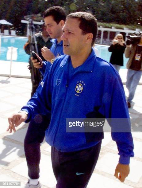 The coach of the Brazilian Soccer Selection Wanderley Luxemburgo walks by the pool in the hotel in Foz de Iguazu Brazil 19 July 2000 Brazil lost to...