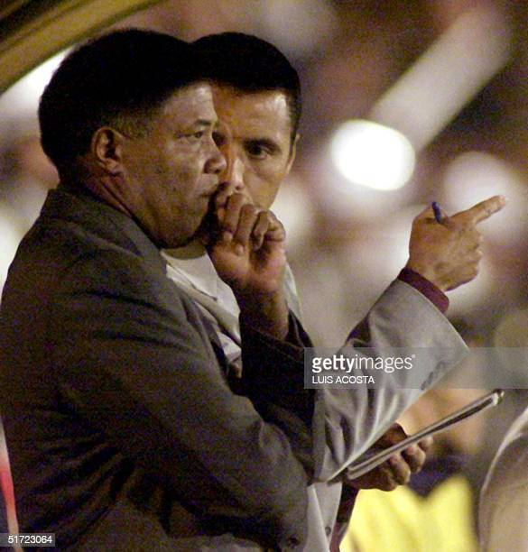 The coach of the Colombian soccer team Francisco Maturana talks to his assistant on August 16 2001 in the El Campin Stadium in Bogota Peru beat...