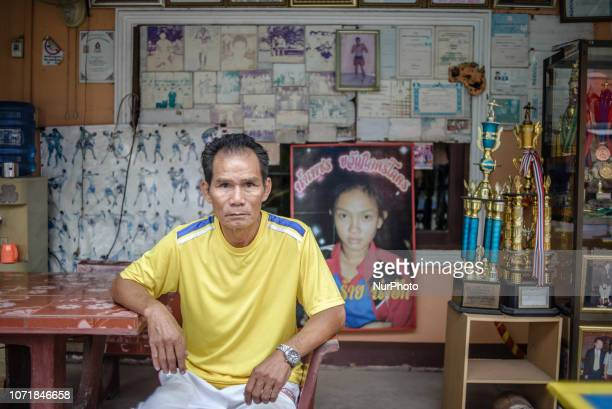 The coach of the Muay Lao school of martial arts with the prizes and awards on the background Vientiane Laos on December 11 2018 Khoun Chai Sikhot...