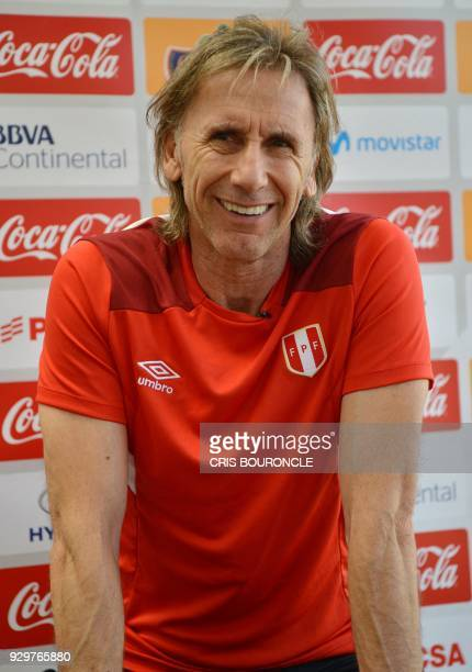 The coach of the Peruvian national football team Argentine Ricardo Gareca smiles during an interview with AFP at the team's headquarters in Lima on...