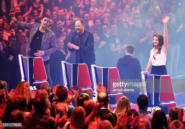 The coaches Andreas Bourani Smudo Michi Beck and Yvonne Catterfeld wave during the semifinals of the SAT1 and ProSieben music casting show 'The Voice...