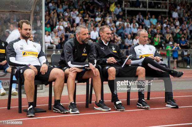 The Coaches Rene Maric Marco Rose Alexander Zickler and Frank Geideck of Borussia Moenchengladbach are seen during the friendly match between...