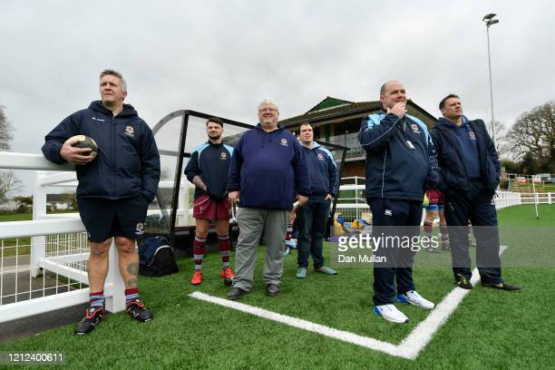 The coaching staff of OPMs look on from the technical area during the Lockie Cup Semi Final match between Old Plymouthian and Mannameadians and...