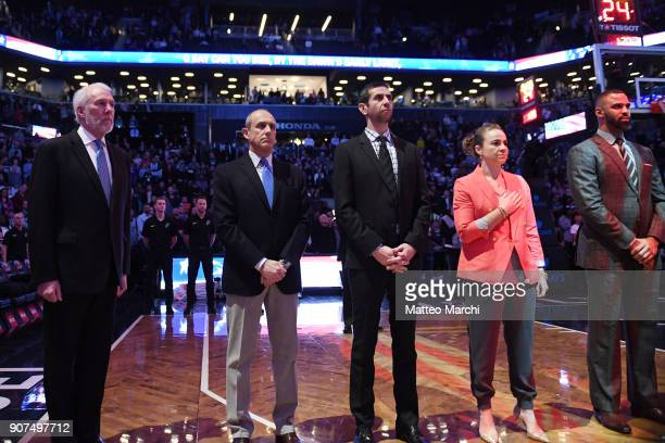 The coaching staff of the San Antonio Spurs lines up before the game against the Brooklyn Nets at Barclays Center on January 17 2018 in Brooklyn New...
