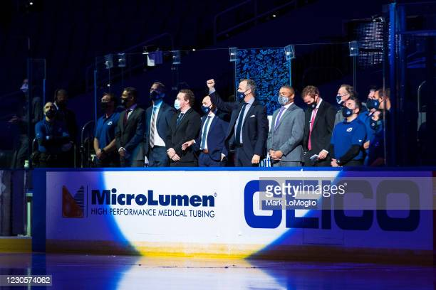 The coaching staff of the Tampa Bay Lightning is honored for winning the Stanley Cup before the game against the Chicago Blackhawks at Amalie Arena...