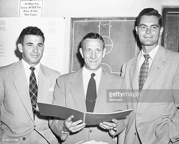 The coaching staff of the UCLA basketball team Assistant Varsity Coach Ed Powell Head Varsity Coach John Wooden and Junior Varsity Coach Al Sawyer
