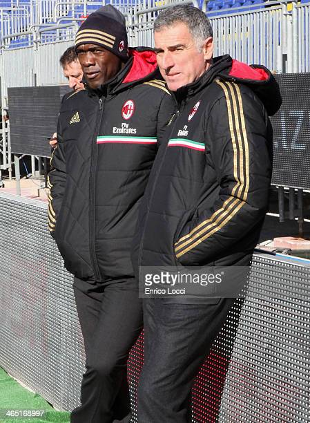 The coah of Milan Clarence Seedorf and Mauro Tassotti during the Serie A match between Cagliari Calcio and AC Milan at Stadio Sant'Elia on January 26...