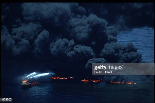 The coast guard attempts to smother the blaze with foam June 11 1990 in the Gulf of Mexico The supertanker began burning crude oil after explosions...