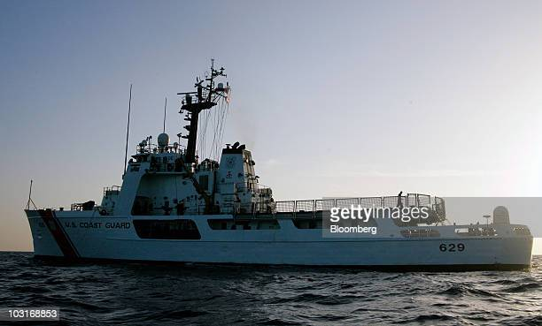 The Coast Guard cutter Decisive works near the BP Plc Macondo well site in the Gulf of Mexico off the coast of Louisiana US on Thursday July 29 2010...