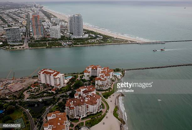 The coast line of Miami Beach and part of Fisher Island are seen June 3 2014 in Miami Florida According to numerous scientists south Florida could be...