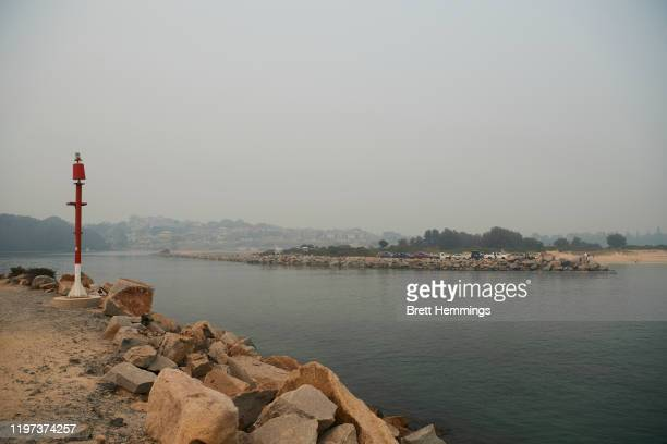 The coast line of Narooma is pictured as smoke covers the horizon on January 04, 2020 in Narooma, Australia. A state of emergency has been declared...