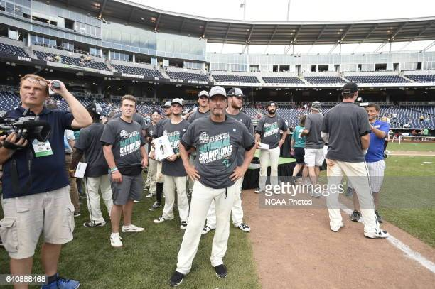 The Coastal Carolina Chanticleers await the trophy presentation after their victory over the University of Arizona during Game 3 of the Division I...