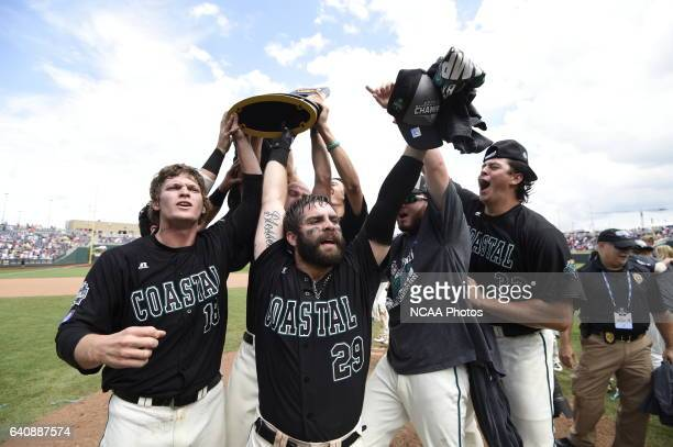 The Coastal Carolina Chanticleers celebrate their victory over the University of Arizona during Game 3 of the Division I Men's Baseball Championship...