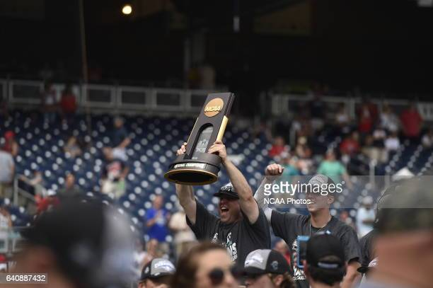 The Coastal Carolina Chanticleers hoist the trophy after their victory over the University of Arizona during Game 3 of the Division I Men's Baseball...