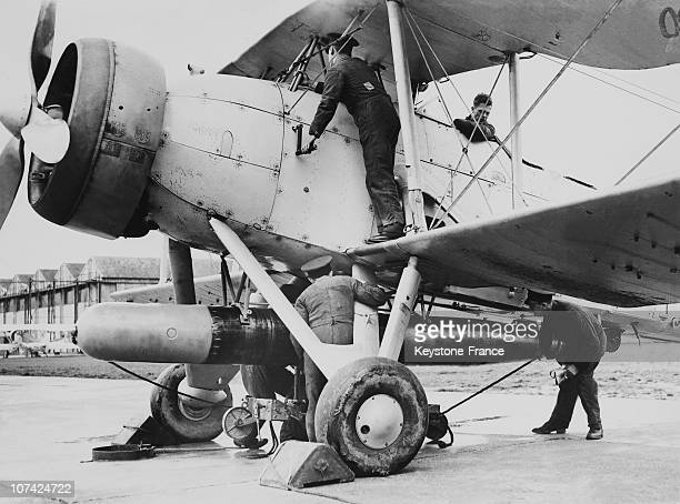 The Coastal Defence From The Air A Torpedo Being Attached To A Fairey Swordfish In England During Thirties