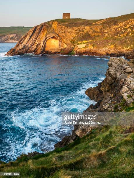 The coastal landscape on the cliffs of Santa Justa at sunset, Cantabria, Spain.
