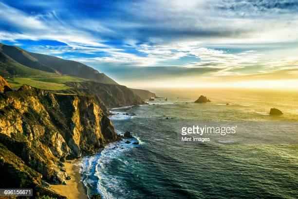 the coastline at big sur in california, with steep cliffs and rock stacks in the pacific ocean. - coastline stock pictures, royalty-free photos & images