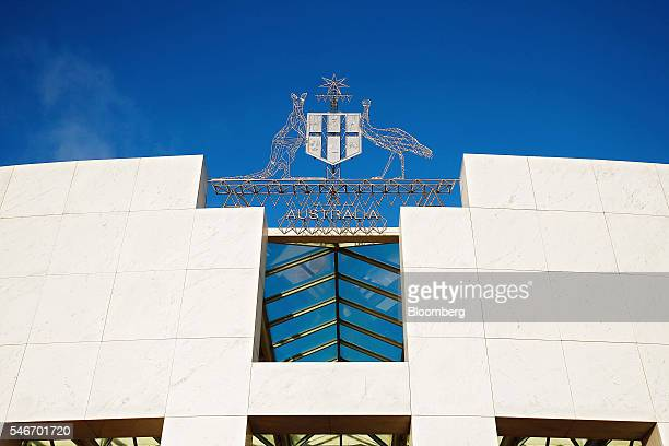 The coat of arms of Australia is displayed above the entrance to Parliament House in Canberra Australia on Tuesday July 12 2016 The projected narrow...