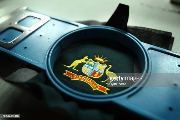 The Coat of Arms of Australia is embroidered during the making the Kookaburra Australian Baggy Green Cap on October 31 2017 in Perth Australia The...