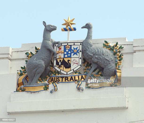 The Coat of Arms of Australia over the old parliament building in Canberra The crest features the Kangaroo and Emu