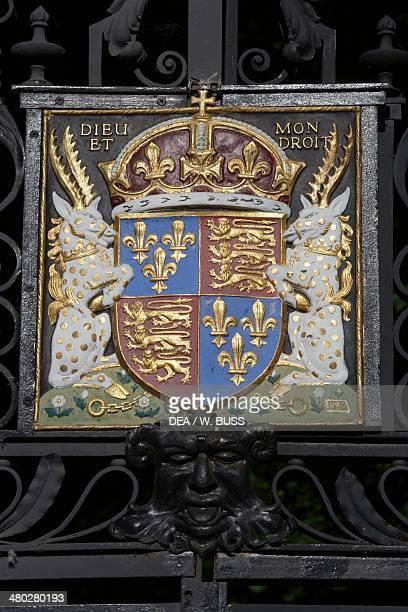 The coat of arms of Edward III wrought iron and enamel on the entrance gate to Trinity College Cambridge Cambdridgeshire United Kingdom