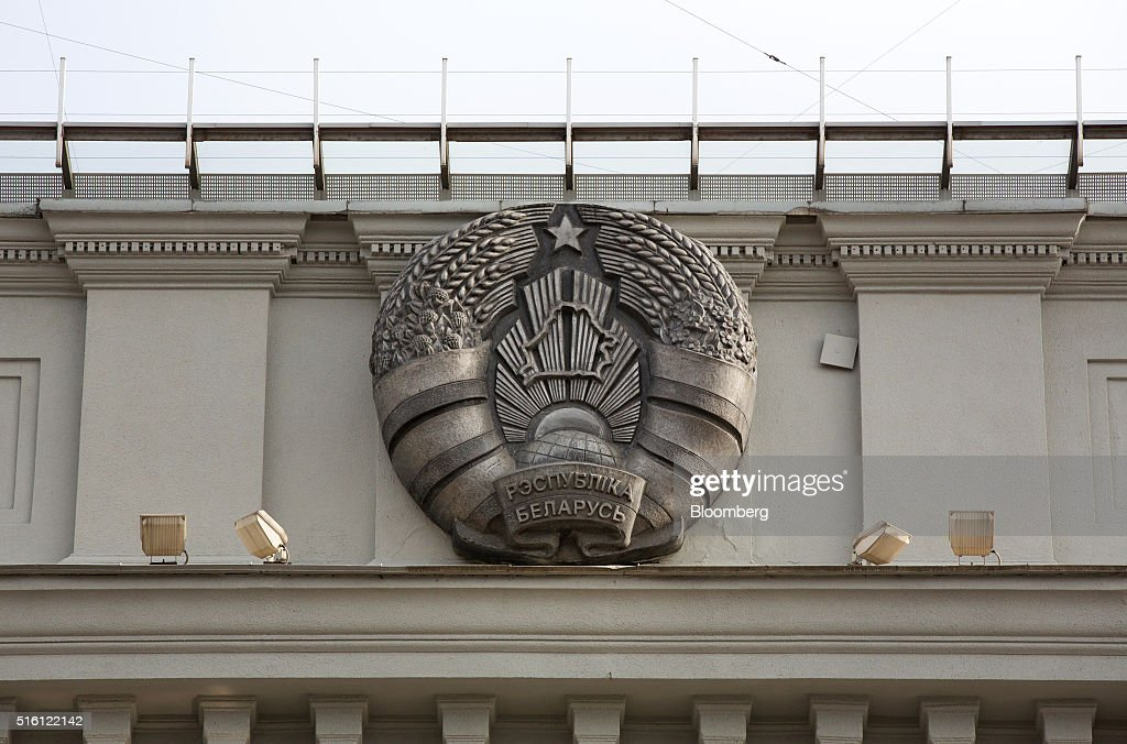 The coat of arms of the Belarus Republic sits on display outside the headquarters of the National Bank of Belarus on Independence avenue in Minsk, Belarus, on Wednesday, March 16, 2016. European Union governments scrapped sanctions on leaders of Belarus in an effort to pry the former Soviet republic out of the shadow of the Kremlin. Photographer: Andrey Rudakov/Bloomberg via Getty Images