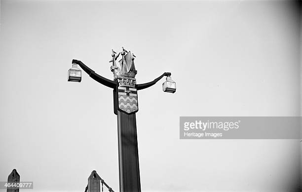 The coat of arms of the City of Westminster London c1945c1965 Coat of arms on a lamppost at the approach to Chelsea Bridge The shield with flag of St...