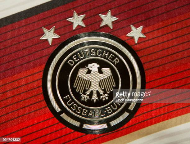 The coat of arms of the German Football Association and the four stars for the won football world championships on a jersey of the national football...