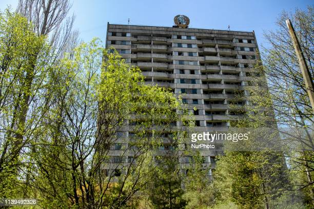 The coat of arms of the Soviet Union is seen on a building in the abandoned city of Prypiat near the Chernobyl nuclear power plant in Ukraine April...